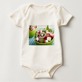 Useful vegetarian salad with raw tomatoes baby bodysuit
