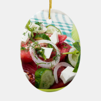 Useful vegetarian salad with raw tomatoes ceramic oval decoration