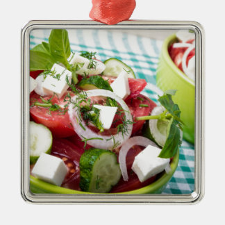 Useful vegetarian salad with raw tomatoes Silver-Colored square decoration