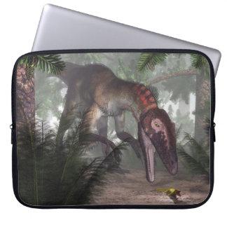 Utahraptor dinosaur hunting a gecko laptop sleeve