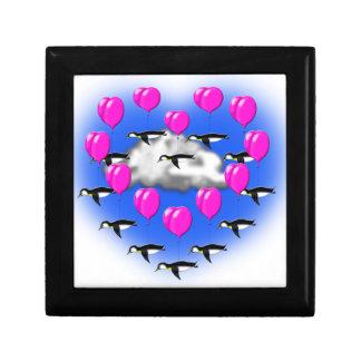 valentines penguins , heartshaped flying gift box