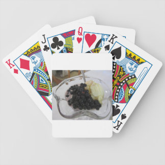 Vanilla ice cream with uncultivated bilberries bicycle playing cards