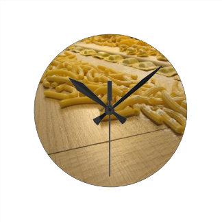 Various mix of fresh italian homemade pasta round clock
