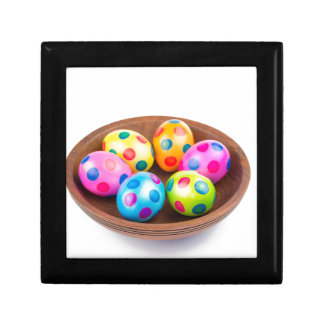 Various painted chicken easter eggs in wooden bowl gift box