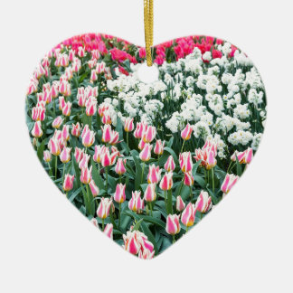 Various red tulips and white daffodils ceramic heart decoration