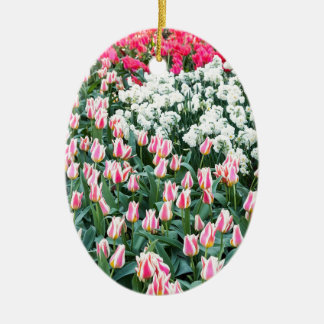 Various red tulips and white daffodils ceramic oval decoration