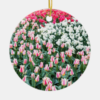 Various red tulips and white daffodils round ceramic decoration