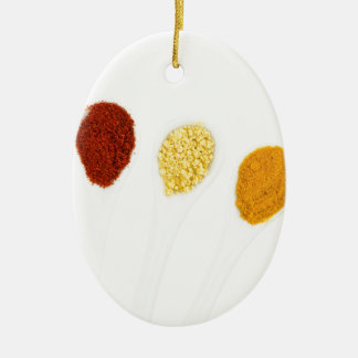 Various seasoning spices on porcelain spoons ceramic oval decoration