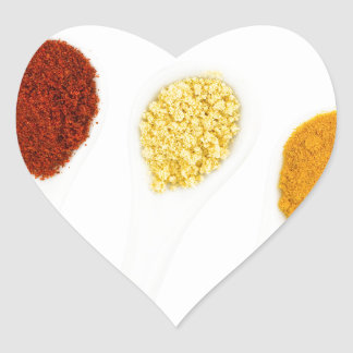 Various seasoning spices on porcelain spoons heart sticker