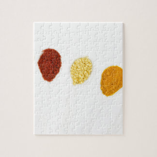 Various seasoning spices on porcelain spoons jigsaw puzzle