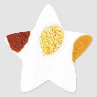 Various seasoning spices on porcelain spoons star sticker