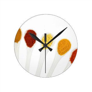 Various seasoning spices on porcelain spoons wallclocks