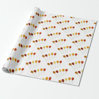 Various seasoning spices on porcelain spoons wrapping paper