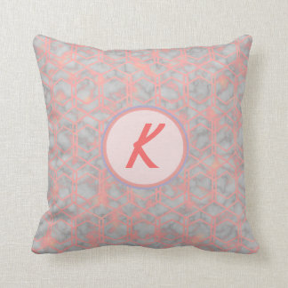 Various shades of pastel pink and monogramed throw pillow