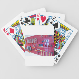 Various tools hanging at wall in high school bicycle playing cards