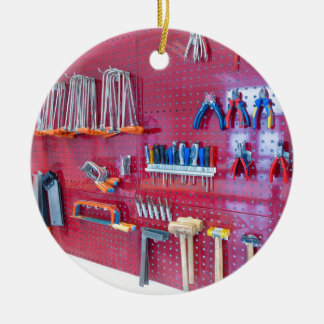 Various tools hanging at wall in high school ceramic ornament