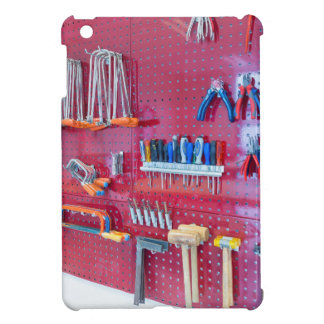 Various tools hanging at wall in high school iPad mini covers