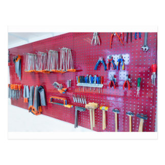 Various tools hanging at wall in high school postcard
