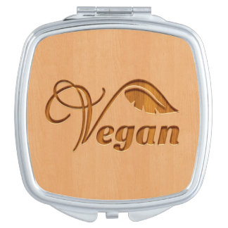 Vegan logo carved in wood effect travel mirrors