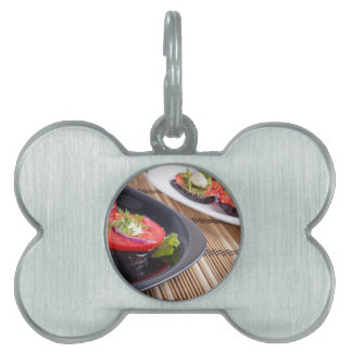 Vegetable dishes of stewed eggplant and fresh red pet tag