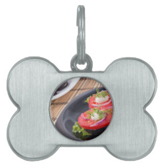 Vegetable dishes of stewed eggplant and fresh red pet tags