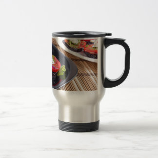 Vegetable dishes of stewed eggplant and fresh red travel mug