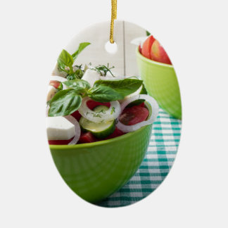 Vegetable vegetarian salad with raw tomato ceramic oval decoration