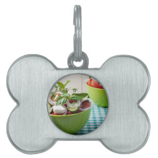 Vegetable vegetarian salad with raw tomato pet name tag