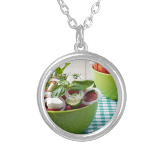Vegetable vegetarian salad with raw tomato silver plated necklace