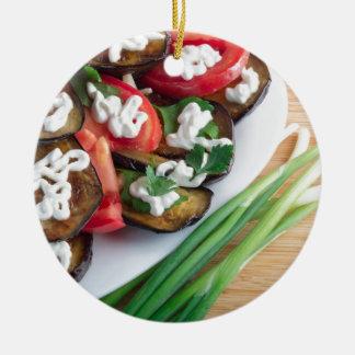 Vegetarian dish of stewed aubergine ceramic ornament