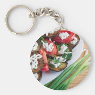 Vegetarian dish of stewed aubergine key ring