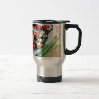 Vegetarian dish of stewed aubergine travel mug