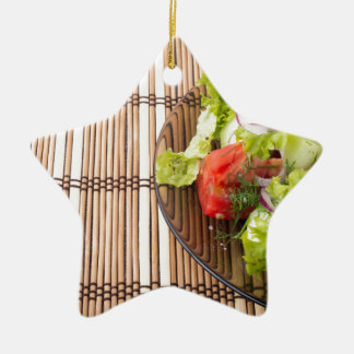Vegetarian salad from fresh vegetables on a bamboo ceramic star decoration