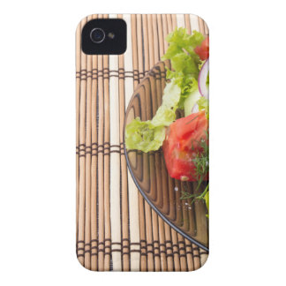 Vegetarian salad from fresh vegetables on a bamboo iPhone 4 cases