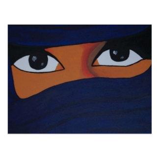 Veiled woman into dark blue postcard