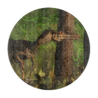 Velociraptor dinosaur in the forest cutting board