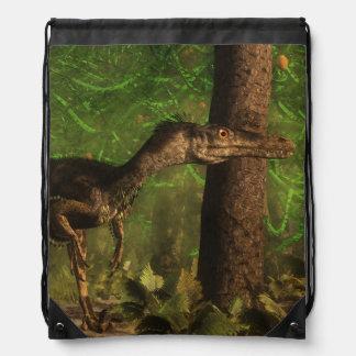 Velociraptor dinosaur in the forest drawstring bag