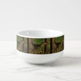 Velociraptor dinosaur in the forest soup mug