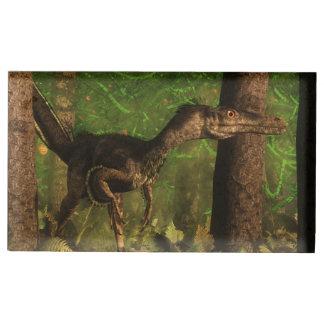 Velociraptor dinosaur in the forest table card holders