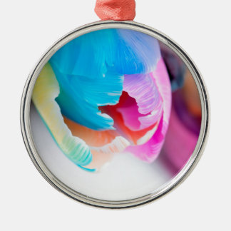 Vertical shoot of unusual multi colored tulip metal ornament