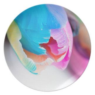 Vertical shoot of unusual multi colored tulip plate