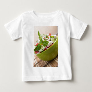 Vertical view close-up on a green bowl with salad baby T-Shirt