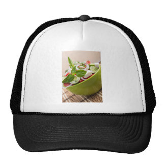 Vertical view close-up on a green bowl with salad cap