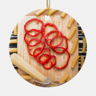 Vertical view on food background from pasta ceramic ornament