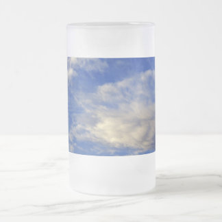 Very structured cloud in a beautiful blue sky frosted glass beer mug