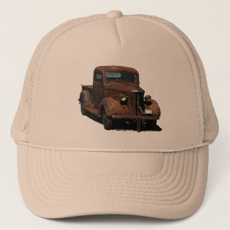 Very weathered '37 Chevy pick up on trucker cap