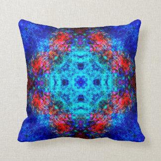 Vibrant red and blue mandala cushion