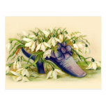 Victorian slipper filled with white flowers postcard