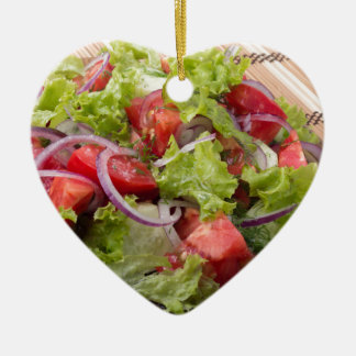 View angle on a fragment of vegetarian salad ceramic heart decoration
