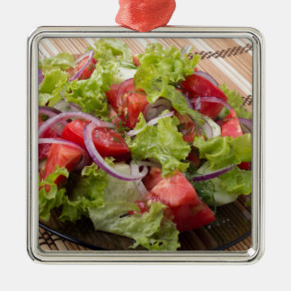 View angle on a fragment of vegetarian salad metal ornament